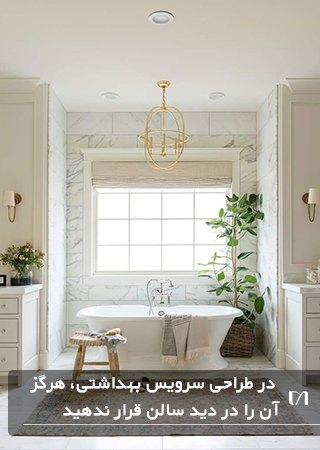 تصیوری حمامی با یک پنجره بزرگ و گلدان بزرگ در پشت وان
