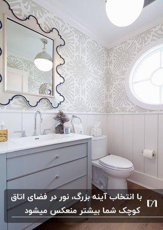 آینه زینتی در اتاق آرایش طوسی سفید با فریم مشکی