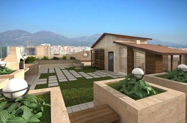 پشت بام خانه با چمن مصنوعی و گلدان سنگی