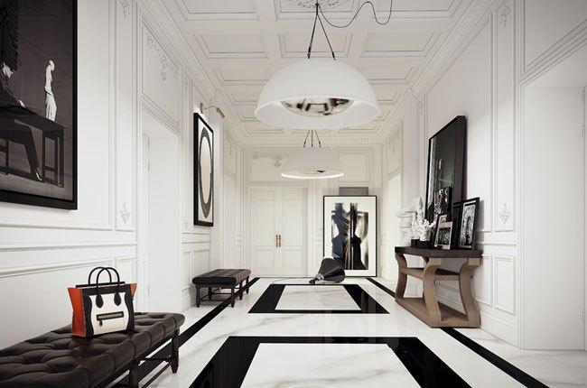 راهروی ورودی آپارتمان با دیوارهای سفید، تابلوهای دیواری مشکی و کفپوش سفید و مشکی