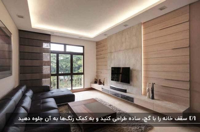 طراحی سقف کاذب گچی نشیمنی با مبلمان ال شکل چرمی و تلوزیون رو به رویش