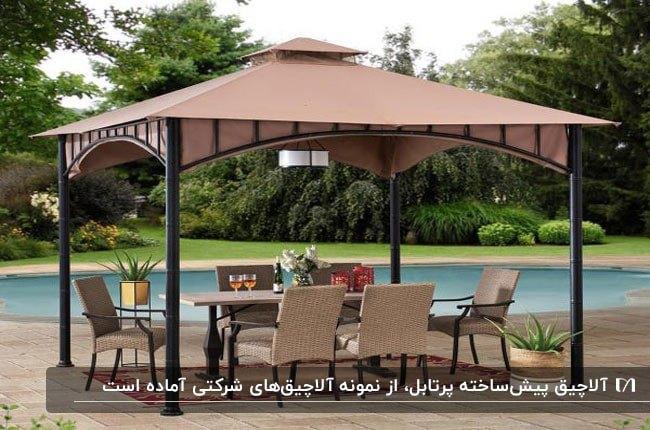 تصویری از یک سایبان پیش ساخته با پایه های فلزی و پارچه سقف کرم با میز و صندلی غذاخوری