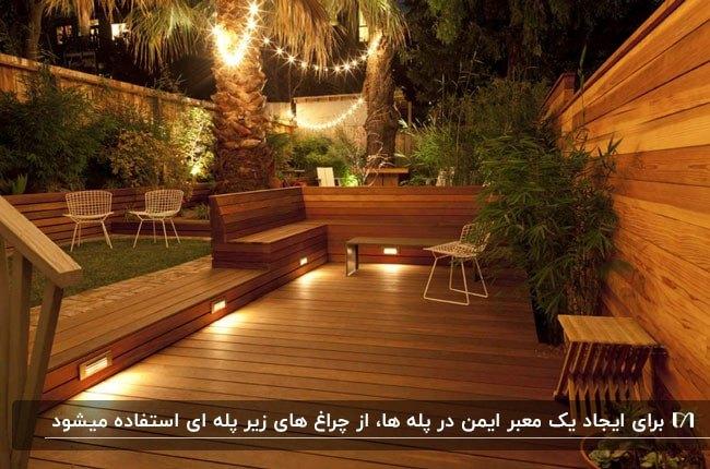 روف گاردنی چوبی با گیاهان متنوع و چراغ های زیرپله ای برای روشنایی در شب