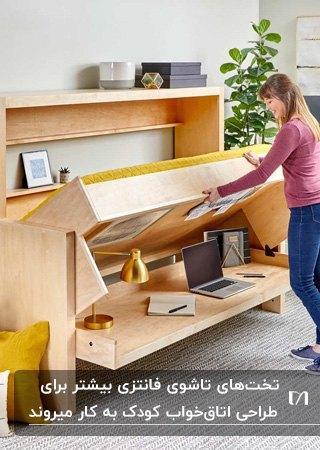 تصویر یک تخت خواب نوجوان فانتزی از جنس چوب به همراه میز تحریر