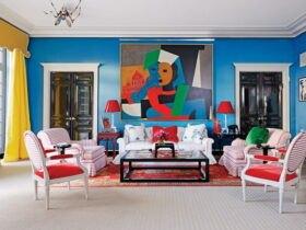 دکوراسیون داخلی نشیمنی با ترکیب همه رنگها برای دیوار، پرده، مبلمان و تابلو نقاشی