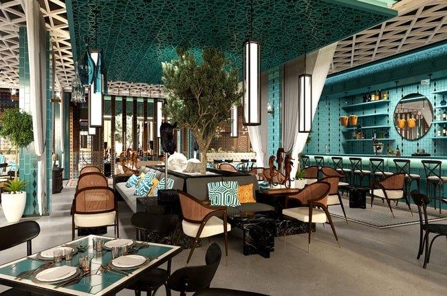 رستورانی مدرن با دیوارها و سقف سبزآبی با صندلی های کرم و قهوه ای و خاکستری