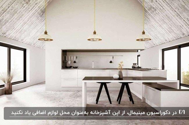 دکوراسیون مینیمال آشپزخانه اپن زیرشیروانی با سه لوستر آویز