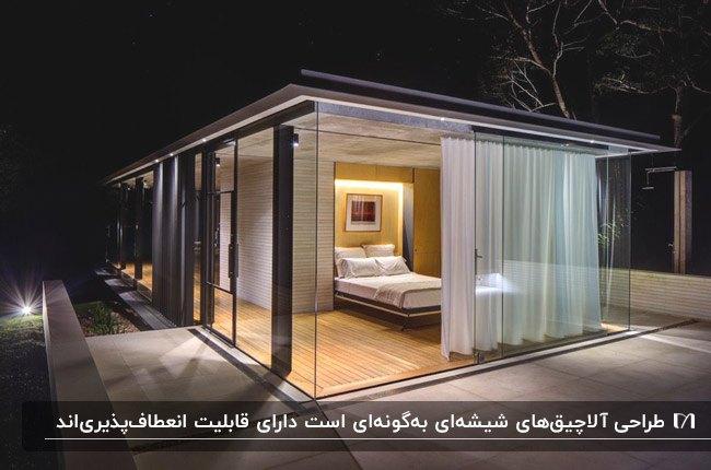 یک آلاچیق شیشه ای به عنوان اتاق خواب با تخت دو نفره در فضای باز